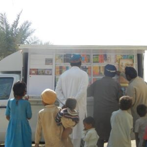 Book van visiting a village