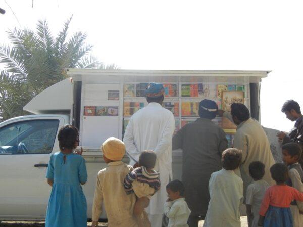 Book van visiting a village