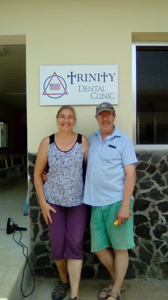 Simon and Grace outside the clinic